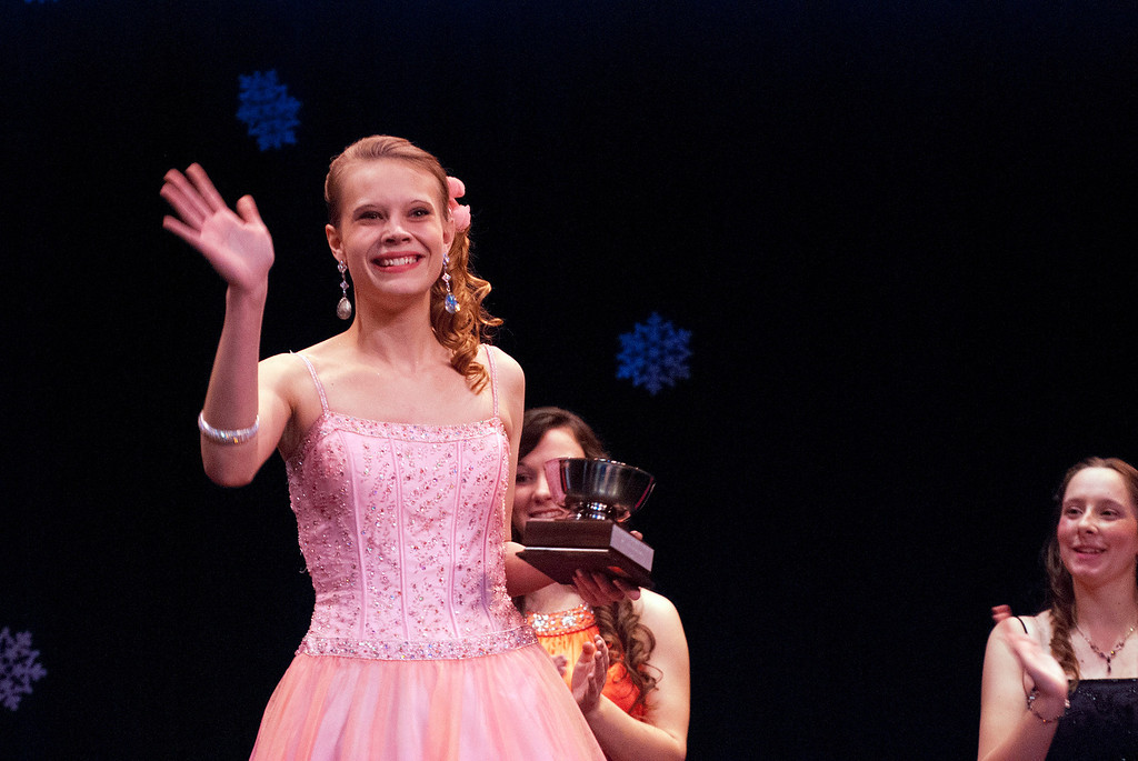 . Kayla Rice/Reformer Fan favorite winner Nicole Koziara waves after being crowned at the 2014 Winter Carnival Queen\'s Pageant on Friday evening.