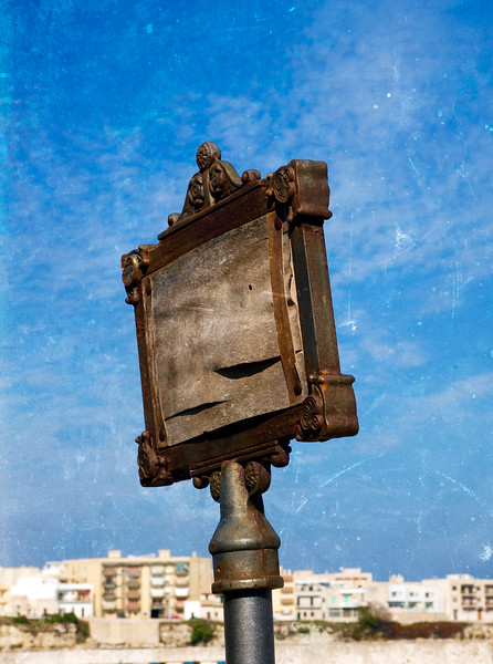 Worn out sign post