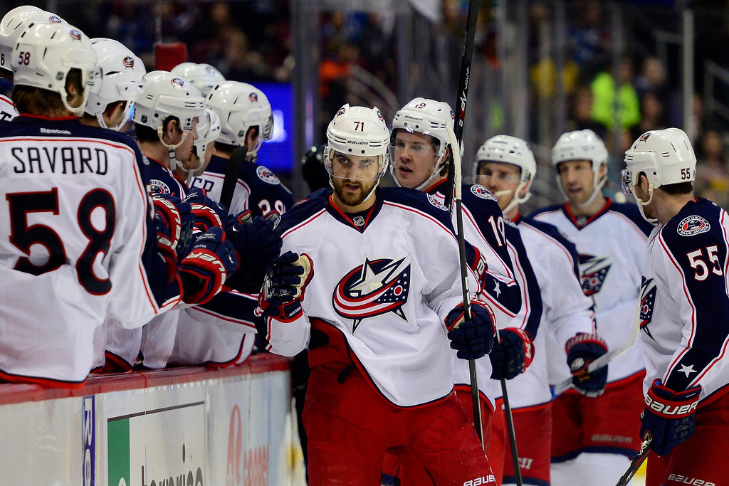 . Nick Foligno (71) of the Columbus Blue Jackets high fives teammates after making an assist on a goal by teammate Ryan Johansen (19) against the Colorado Avalanche during the first period. The Colorado Avalanche hosted the Columbus Blue Jackets at the Pepsi Center on Tuesday, December 31, 2013. (Photo by AAron Ontiveroz/The Denver Post)