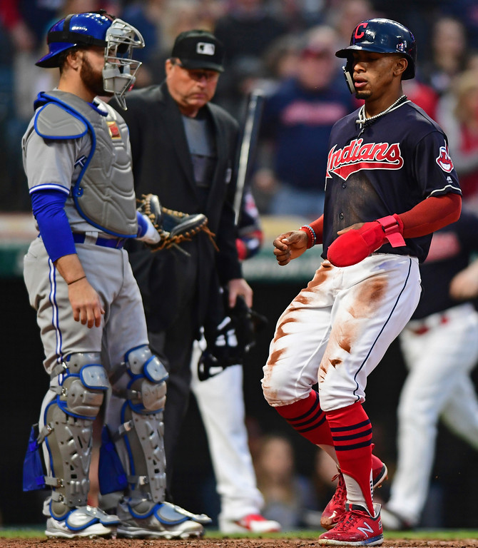 . Cleveland Indians Francisco Lindor scores on a RBI-double by Jason Kipnis in the second inning of a baseball game against the Toronto Blue Jays, Friday, April 13, 2018, in Cleveland. (AP Photo/David Dermer)