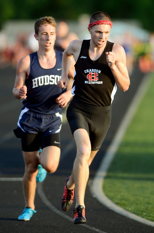 . Maribeth Joeright/MJoeright@News-Herald.com<p> Chardon\'s Nick Elswick maintains his lead over Hudson\'s Kyle Mau and was the winner boys 3200 meter run with a time of 8:57:93 and Division I regional record, May 30, 2014.