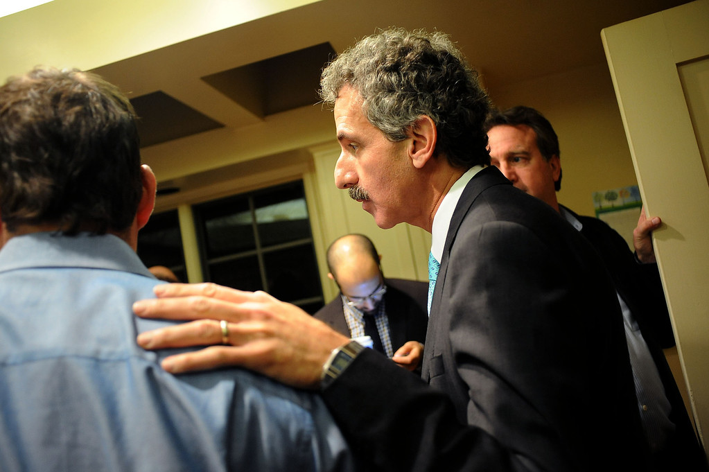 . City Attorney candidate Mike Feuer keeps an eye on a television as early election numbers come in during his election night party in Los Angeles, CA March 5, 2013.(Andy Holzman/Los Angeles Daily News)