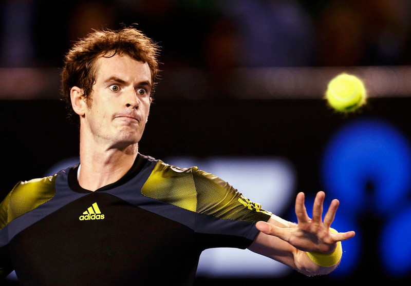. Andy Murray of Britain hits a return to Novak Djokovic of Serbia during their men\'s singles final match at the Australian Open tennis tournament in Melbourne January 27, 2013. REUTERS/Tim Wimborne
