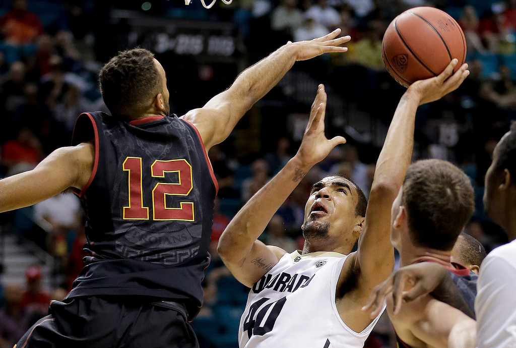 . Colorado\'s Josh Scott shoots against Southern California\'s Julian Jacobs in the first half of an NCAA college basketball game in the Pac-12 men\'s tournament, Wednesday, March 12, 2014, in Las Vegas. (AP Photo/Julie Jacobson)