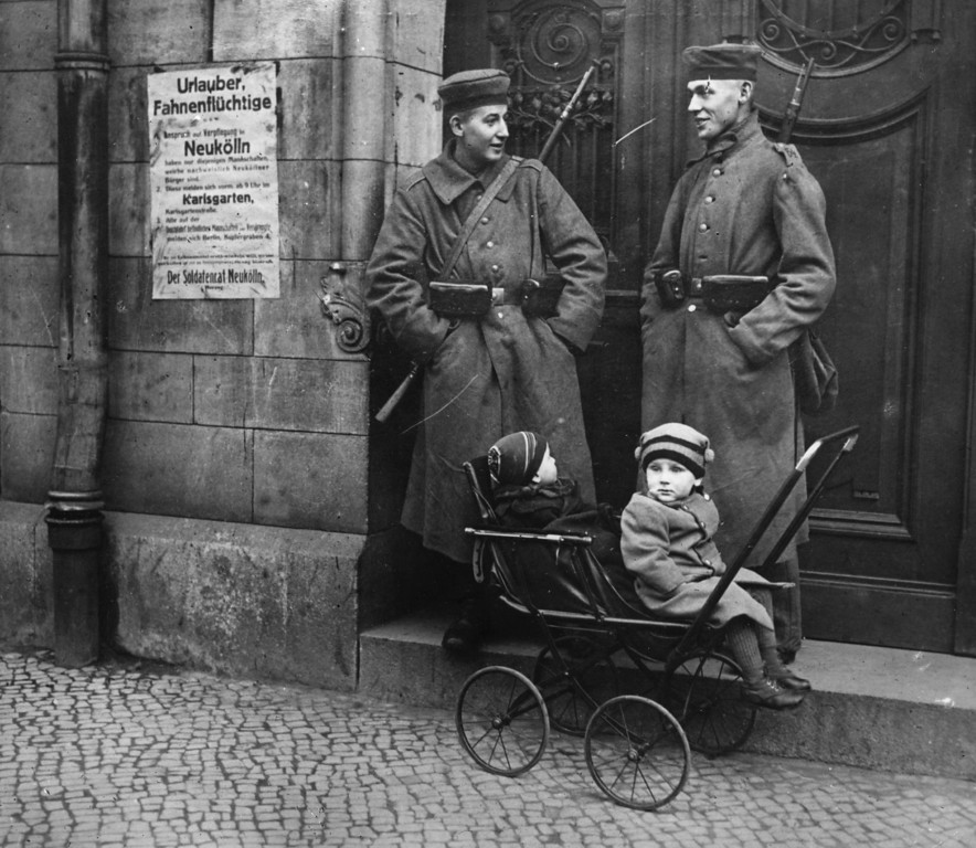 . Policemen looking after children while on duty in Berlin, during the revolution which broke out following Germany\'s defeat in World War I.   (Photo by Topical Press Agency/Getty Images)