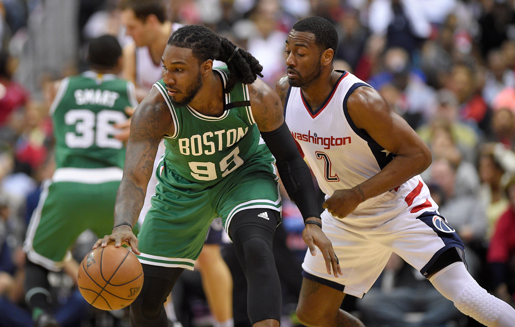 . Boston Celtics forward Jae Crowder (99) dribbles against Washington Wizards guard John Wall (2) during the first half in Game 4 of a second-round NBA basketball playoff series, Sunday, May 7, 2017, in Washington. (AP Photo/Nick Wass)