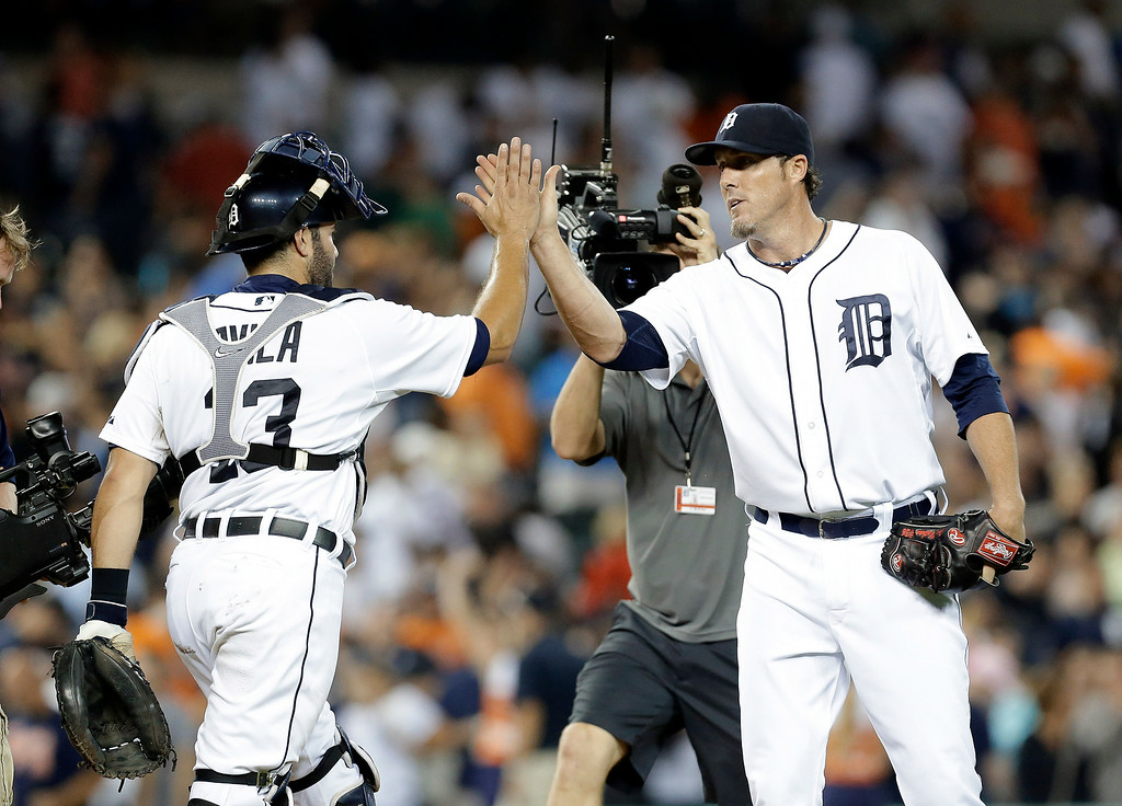 . Detroit Tigers catcher Alex Avila (13) congratulates relief pitcher Joe Nathan after beating the New York Yankees 5-2 in a baseball game in Detroit Tuesday, Aug. 26, 2014. Detroit won 5-2. (AP Photo/Paul Sancya)