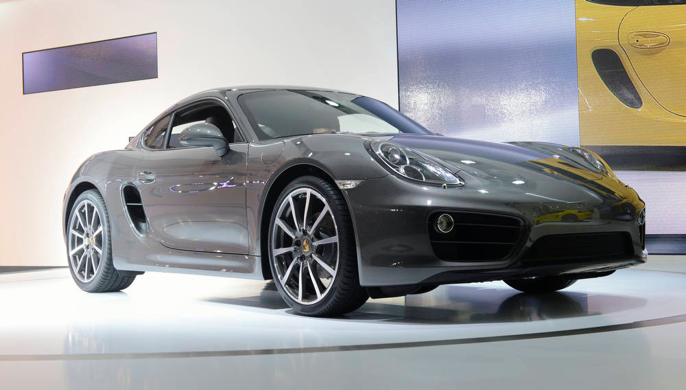 Description of . The 2013 Porsche Cayman is unveiled during a news conference at the 2012 Los Angeles Auto Show in Los Angeles, California November 28, 2012.  REUTERS/Phil McCarten