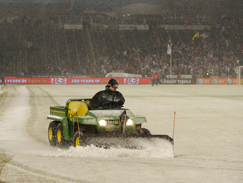 . COMMERCE CITY, CO. - MARCH 22: Workers tried to plow snow off the field before the game. The U.S. Men\'s National Soccer Team hosted Costa Rica Friday night, March 22, 2013 in a FIFA World Cup qualifier at Dick\'s Sporting Goods Park in Commerce City.  (Photo By Karl Gehring/The Denver Post)