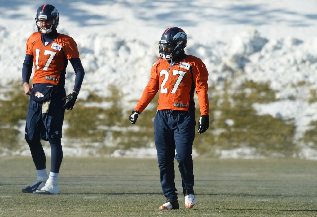 . Brock Osweiler (17), left, and Knowshon Moreno (27), of Denver Broncos warming up at the practice field in Denver Broncos Headquarters at Dove Valley in Englewood, Colorado on Friday,  December 6, 2013. (Photo by Hyoung Chang/The Denver Post)
