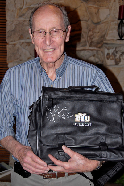 2011/3/28a – Dad with his Jimmer Fredette autographed bag. He thought it was so cool. Thanks to Brooke Renslow (Sean's girlfriend, BYU cheerleader and best friend to Jimmer's girlfriend) for getting the autograph. She took the bag to New Orleans and had Jimmer sign it just before their Sweet 16 game with Florida.