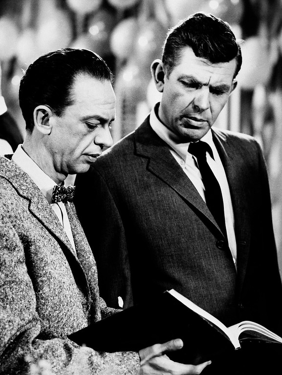 """. FILE - This Jan. 24, 1963 file photo shows actors Andy Griffith as Sheriff Andy Taylor, right, and Don Knotts as Deputy Barney Fife, in a scene from the \""""The Andy Griffith Show.\""""  Griffith, whose homespun mix of humor and wisdom made \""""The Andy Griffith Show\"""" an enduring TV favorite, died Tuesday, July 3, 2012 in Manteo, N.C. He was 86. (AP Photo, file)"""