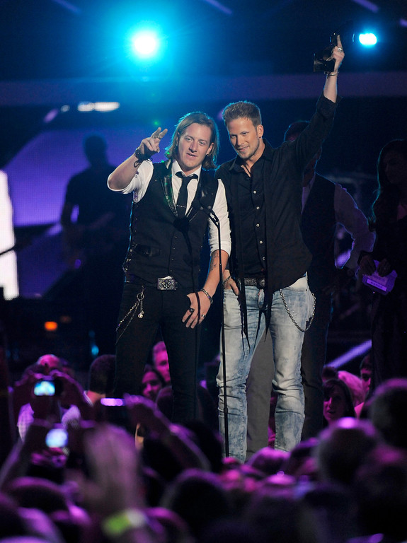 ". Tyler Hubbard, left, and Brian Kelley, of Florida Georgia Line accept the award for duo video of the year for ""Cruise\"" at the 2013 CMT Music Awards at Bridgestone Arena on Wednesday, June 5, 2013, in Nashville, Tenn. (Photo by Donn Jones/Invision/AP)"