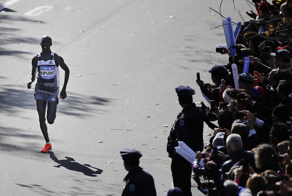 . Wilson Kipsang of Kenya approaches the finish line during the 2014 New York City Marathon in New York, Sunday, Nov. 2, 2014. Kipsang finished in 2:10:55 ó more 7 1/2 minutes off his former record. (AP Photo/Seth Wenig)