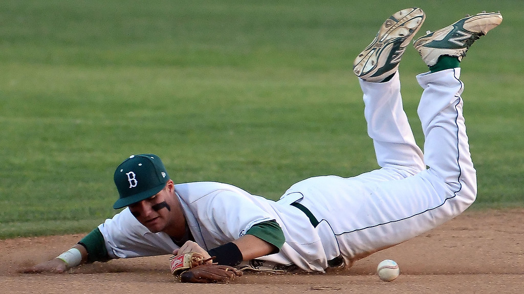 . San Dimas\' Jonathan Longtin (not pictured) singles as Bonita shortstop Joe Quire dives for the baseball in the third inning of a prep baseball game at Bonita High School in La Verne, Calif., on Wednesday, March 19, 2014.  (Keith Birmingham Pasadena Star-News)