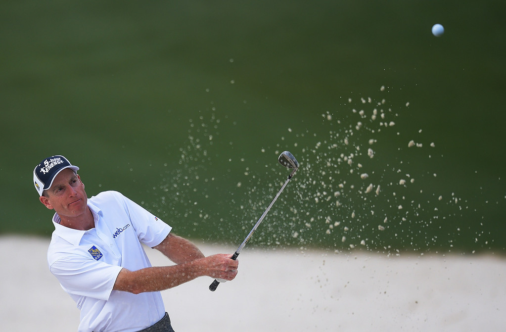 . Jim Furyk of the US plays a shot out of a bunker on the 10th hole during the final round of the 78th Masters Golf Tournament at Augusta National Golf Club on April 13, 2014 in Augusta, Georgia.    JIM WATSON/AFP/Getty Images