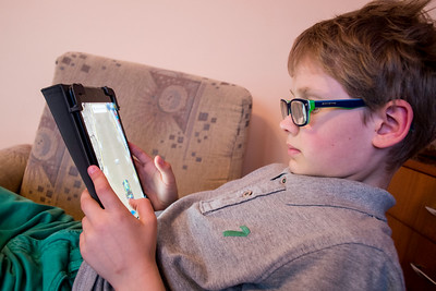 Boy age 8-9 using ipad in Starachowice, Poland