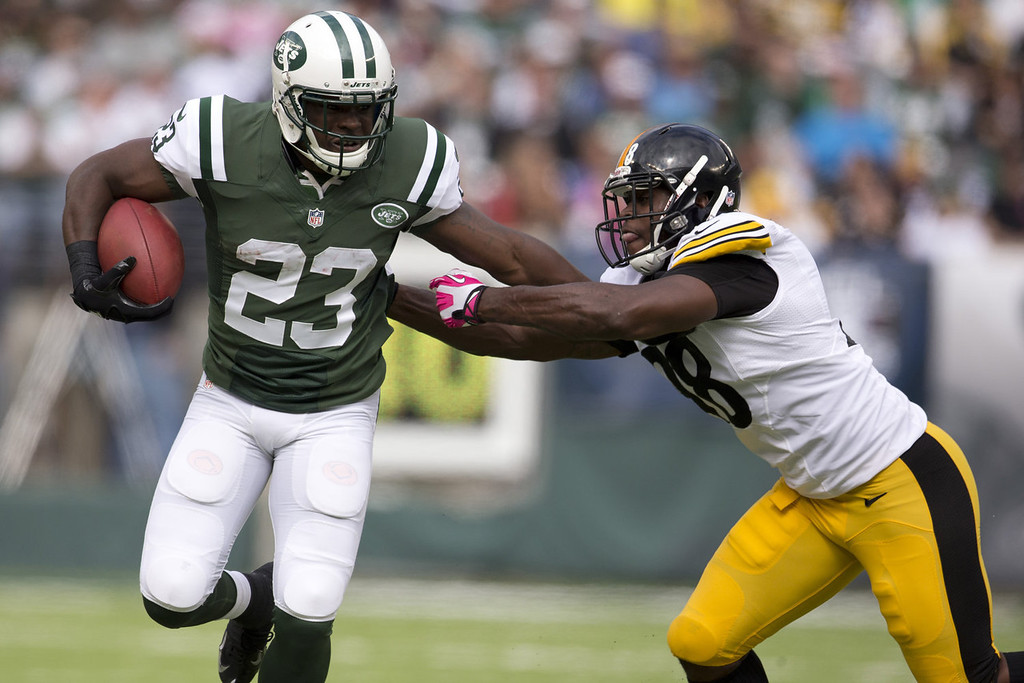 . Running back Mike Goodson #23 of the New York Jets stiff arms defensive back Cortez Allen #28 of the Pittsburgh Steelers on October 13, 2013 at MetLife Stadium in East Rutherford, New Jersey. (Photo by Mitchell Leff/Getty Images)