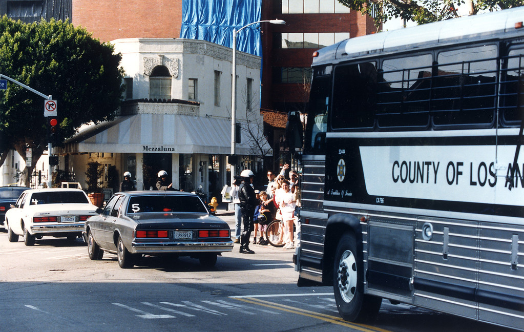 . The O.J. Simpson trial motorcade drives past Mezzaluna restaurant Sunday in Brentwood. Victim Ronald Goldman was a waiter at the restaurant and served Nicole Simpson her last meal.   (2/12/95)   (Los Angeles Daily News file photo)
