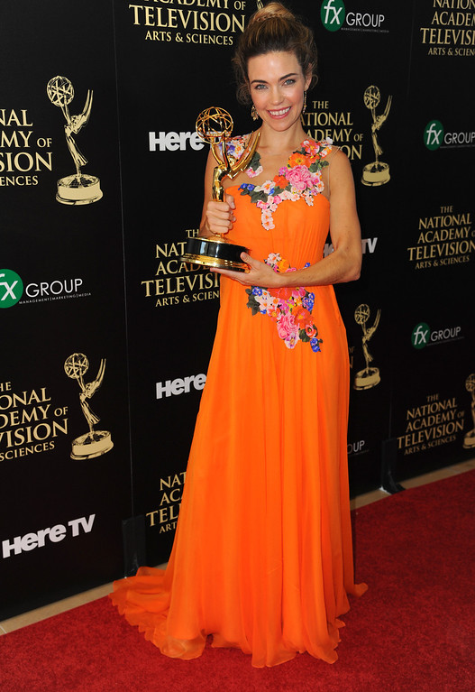 . Amelia Heinle poses in the press room with the award for outstanding supporting actress in a drama series for ìThe Young and the Restlessî at the 41st annual Daytime Emmy Awards at the Beverly Hilton Hotel on Sunday, June 22, 2014, in Beverly Hills, Calif. (Photo by Richard Shotwell/Invision/AP)