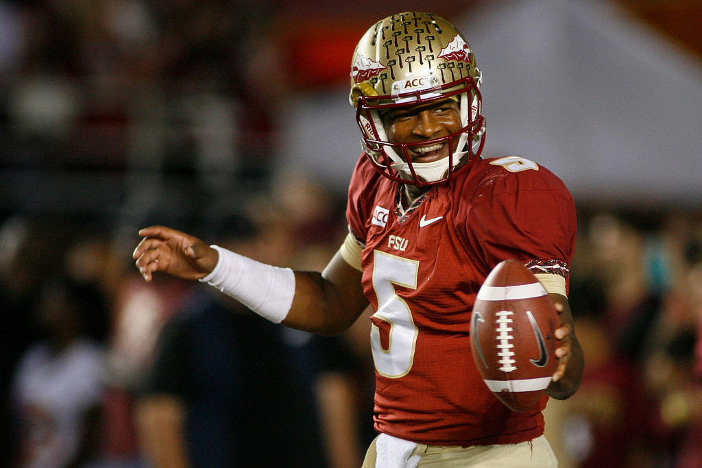 . In this Nov. 2, 2013 file photo, Florida State quarterback Jameis Winston (5) smiles before the start of an NCAA college football game against Miami, in Tallahassee, Fla. Winston envisioned winning the Heisman Trophy before signing with the top-ranked Seminoles. (AP Photo/Phil Sears, File)