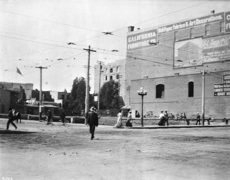 Broadway at the corner of Seventh Street showing a building advertising for the California Furniture Company, Los Angeles, ca.1906