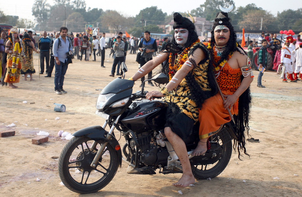 . Indian Hindu devotees dressed as Lord Shiva sit on a motorbike as they take part in the Mahashivratri procession during the Mahashivratri festival celebrations in Jammu, the winter capital of Kashmir, India, 26 February 2014. Maha Shivratri, the night of the worship of Shiva, occurs on the 14th night of the new moon during the dark half of the month when Hindus offer special prayer to the lord of destruction.  EPA/JAIPAL SINGH