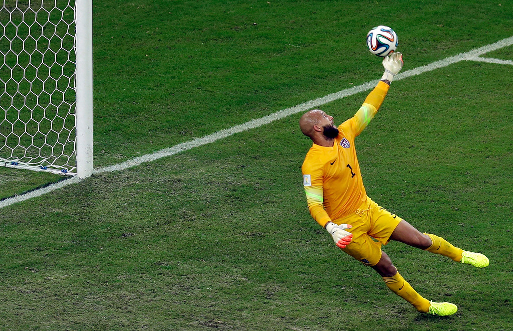 . United States\' goalkeeper Tim Howard tips a ball to deflect it over the goal during the group G World Cup soccer match between the USA and Portugal at the Arena da Amazonia in Manaus, Brazil, Sunday, June 22, 2014. (AP Photo/Themba Hadebe)