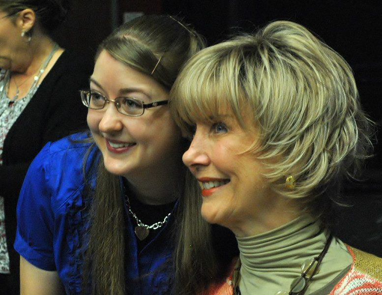 Joni Eareckson Tada poses for photos with community members and students after speaking at dimensions.