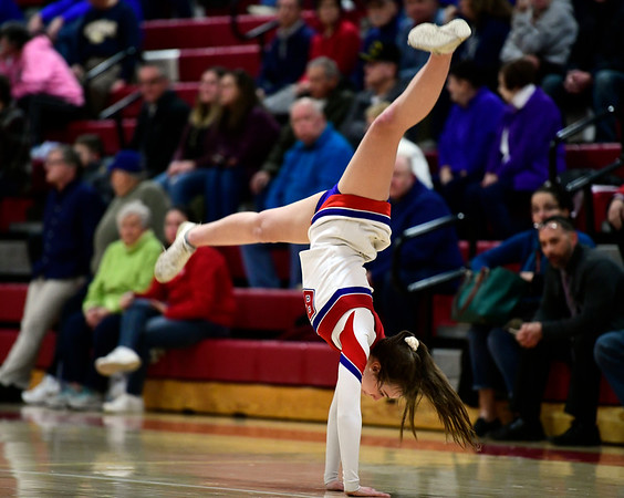 2/26/2019 Mike Orazzi | Staff A Berlin High School Cheerleader during the CIAC 2019 State Girls Basketball Tournament with Plainville at Berlin High School Tuesday night.