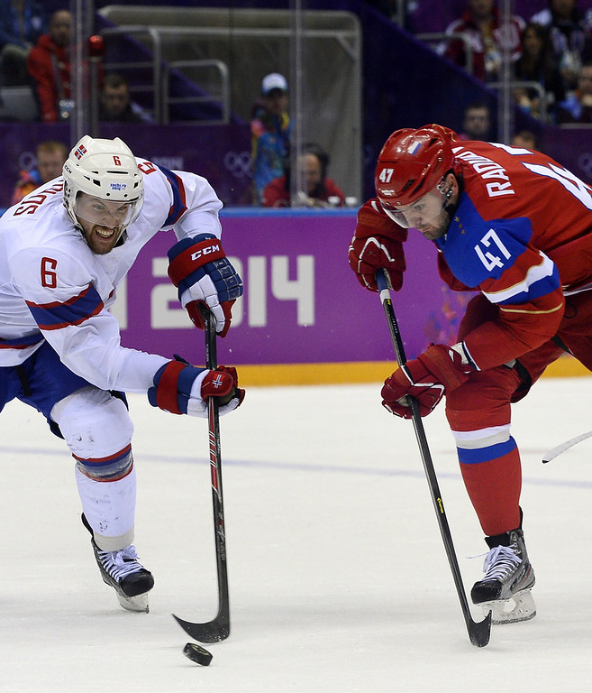 . Russia\'s Alexander Radulov (R) vies with Norway\'s Jonas Holoes during the Men\'s Ice Hockey play-offs qualification match Russia vs Norway at the Bolshoy Ice Dome during the Sochi Winter Olympics on February 18, 2014.  (JONATHAN NACKSTRAND/AFP/Getty Images)