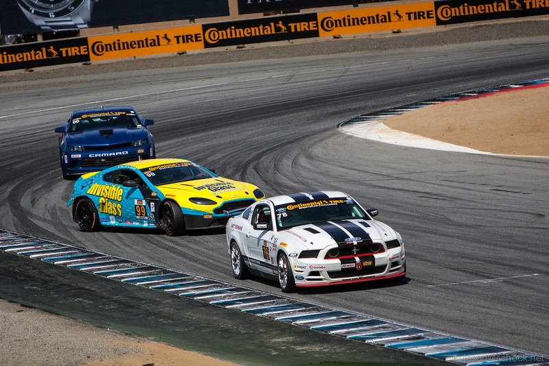The Invisible Glass Aston Martin Vantage GT4 earns some style points on the final turn of the Continental Tire race.