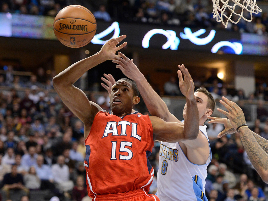 . Al Horford (15) of the Atlanta Hawks has the ball knocked away by Danilo Gallinari (8) of the Denver Nuggets during the third quarter March 4,  2013 at Pepsi Center. The Denver Nuggets defeated the Atlanta Hawks 104-88. (Photo By John Leyba/The Denver Post)