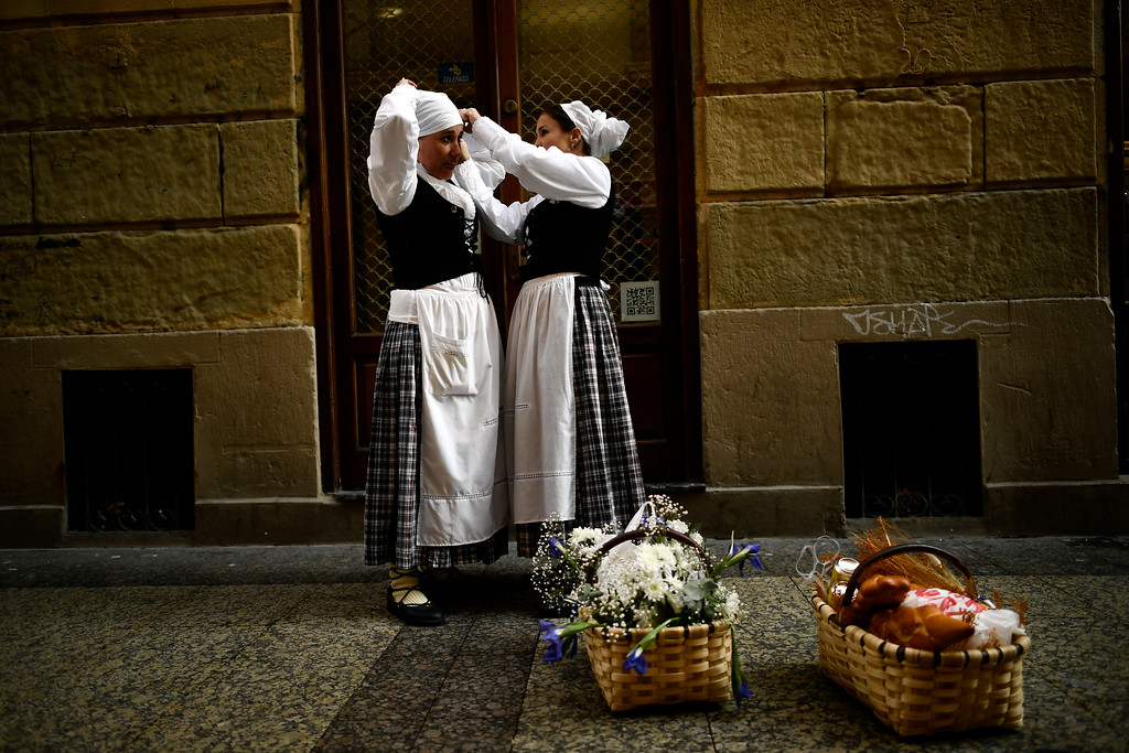 """. Two female \""""Tamborilleros\"""" wearing their uniforms prepare to take part in the traditional \'La Tamborrada\', during \'El Dia Grande\', the main day of San Sebastian feasts, in the Basque city of San Sebastian, northern Spain, Friday, Jan. 20, 2017. From midnight to midnight companies of perfectly uniformed marchers parade through the streets of San Sebastian playing drums and barrels in honor of their patron saint. (AP Photo/Alvaro Barrientos)"""