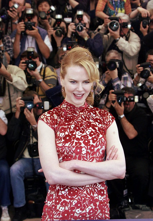 ". Actress Nicole Kidman poses during a photocall for her film ""Moulin Rouge\"" directed by Australia\'s Baz Luhrmann, which will be screened in competition at the 54th International Film Festival in Cannes, southern France, Wednesday, May 9, 2001. (AP Photo/Lionel Cironneau)"