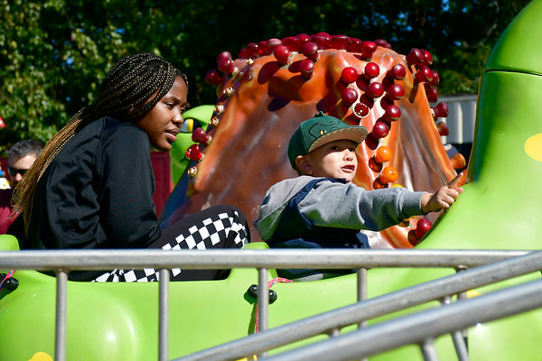 10/5/2019 Mike Orazzi | StaffrAnjali Rowe and Gabriel Lopez ride rides while at the 51st Annual Apple Harvest Festival in Southington on Saturday.