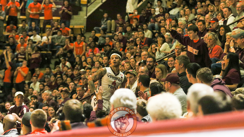 Seth Allen ends up in the stands after chasing a loose ball over the TV announcer desk. (Mark Umansky/TheKeyPlay.com)