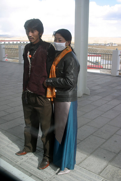Couple just watching the train, they didn't move at all during our stop, NA QU station stop, 14,803ft (4513M) Elevation Qinghai -Beijing to Tibet Railway, Beijing to Lhasa  Oct  2006