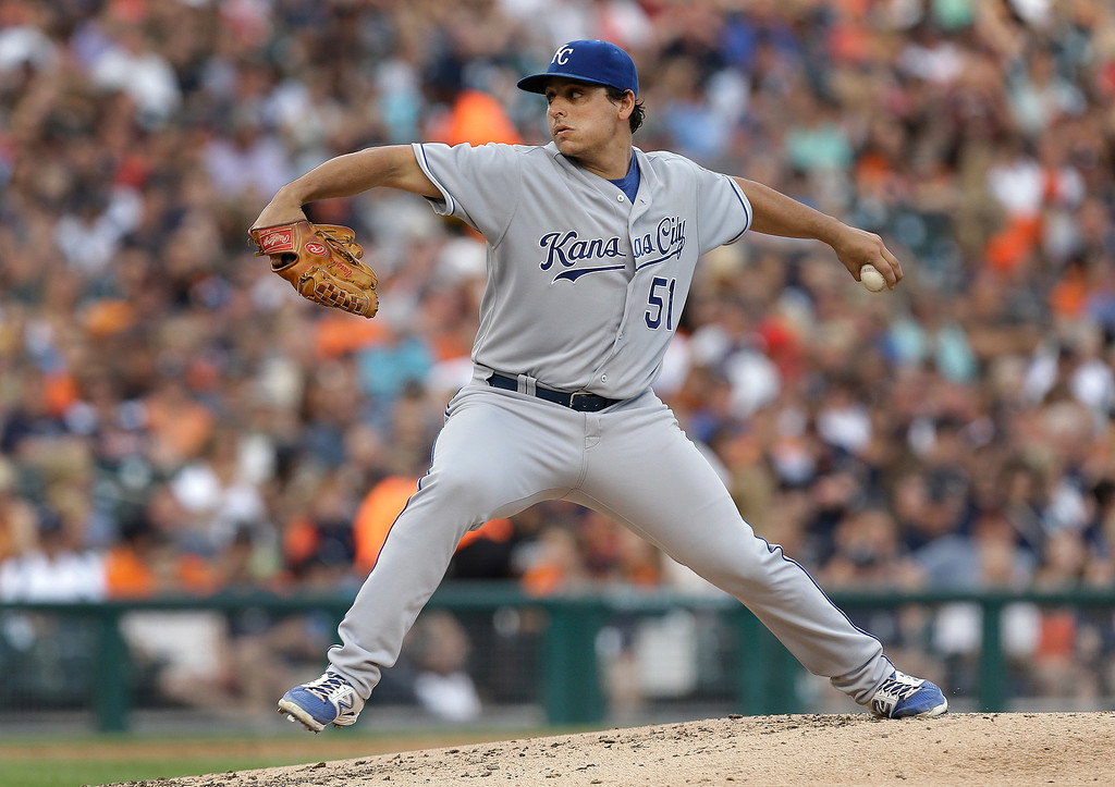 . Kansas City Royals pitcher Jason Vargas throws against the Detroit Tigers in the third inning of a baseball game in Detroit, Monday, June 16, 2014.  (AP Photo/Paul Sancya)