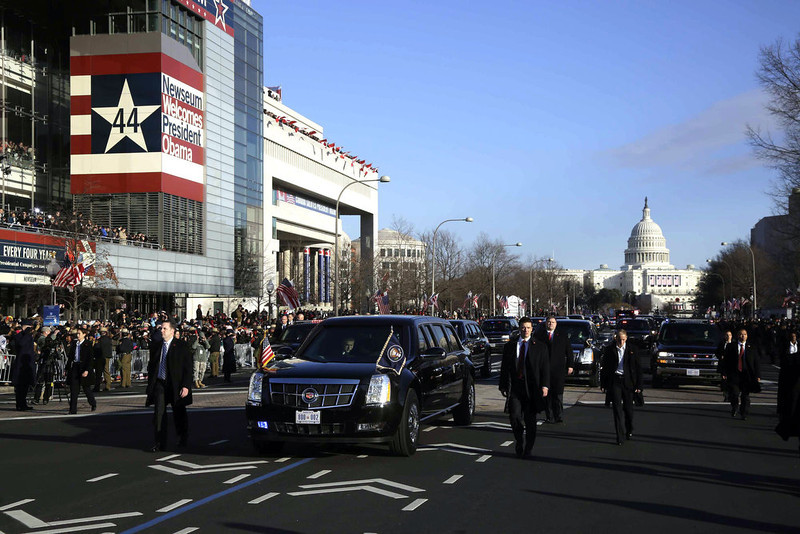 . President Barack Obama and first lady Michelle Obama ride in the presidential limousine during the 57th Presidential Inauguration parade down Pennsylvania Avenue Monday, Jan. 21, 2013, in Washington. (AP Photo/Charles Dharapak)
