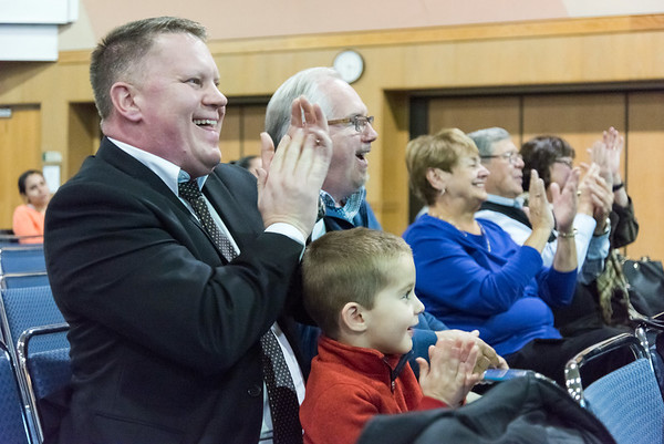 11/12/18 Wesley Bunnell | Staff CCSU held a Veterans Day Observance on Monday afternoon in Alumni Hall which featured honoring three local veterans. John R. Truhan and son Andrew Truhan, age 2, applause John's father Jack Truhan as he receives his awards.