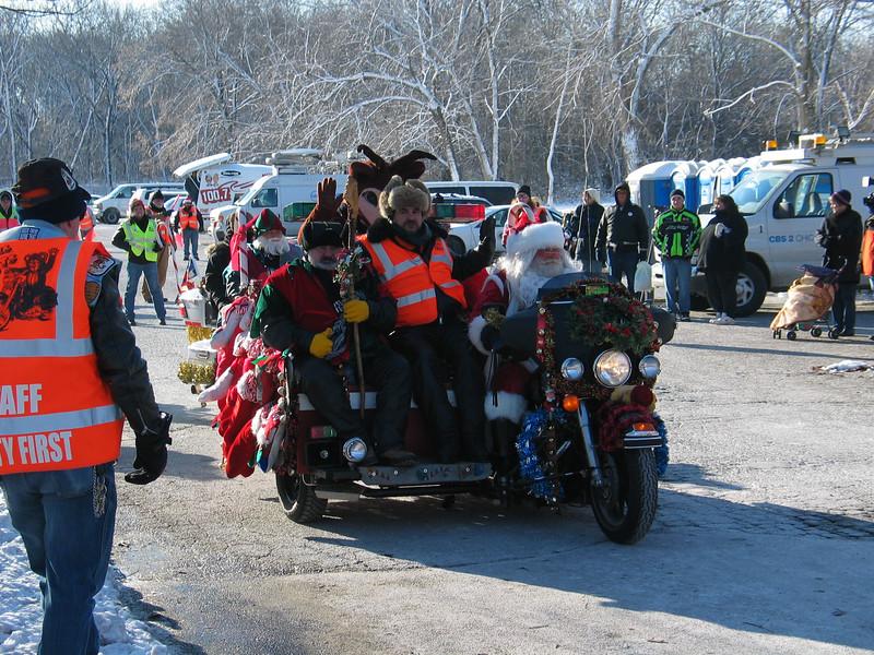 Santa, elf & reindeer on a motorcycle