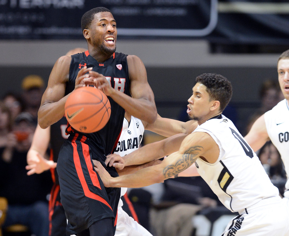 . Askia Booker, right, of Colorado, knocks the ball from Jarrod DuBois of Utah during the first half of the February 21st, 2013 game in Boulder. For more photos of the game, go to www.dailycamera.com. Cliff Grassmick / February 21, 2013