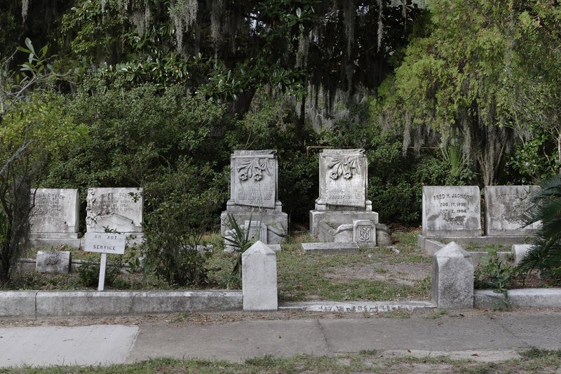 "Dark, still, quiet, creepy Bonaventure Cemetery, founded as a family plot two centuries ago about 20 minutes outside of Savannah.  This sprawling, dirt road-covered site, situated on a river, is overrun by huge, sprawling live oak trees dripping with Spanish moss, creating a canopy of dark green overhead.  Scene of voodoo, sex and intrigue in _Midnight in the Garden of Good and Evil_ and original site of the iconic ""Bird Girl"" statue that adorns the cover of that book.  Many plots here have statues portraying those buried within the mostly above-ground sarcophaguses.  Governors, generals, philanthropists and 'lesser' souls as well are buried here.  Today, it's said by those so inclined that you can hear--but not see--the cemetery's 'ghost dogs' howling, barking, prowling and panting here late at night.  © Shams Tarek (www.shamstarek.com)"