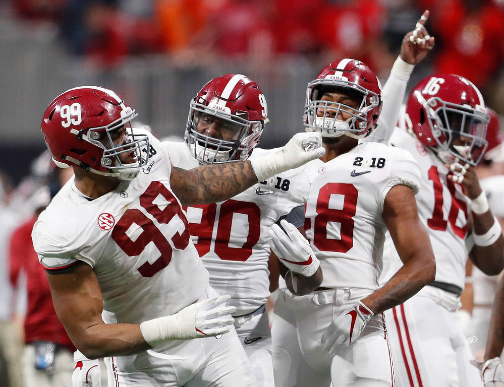 . Alabama\'s Raekwon Davis (99) celebrates his interception during the second half of the NCAA college football playoff championship game against Georgia Monday, Jan. 8, 2018, in Atlanta. (AP Photo/David Goldman)