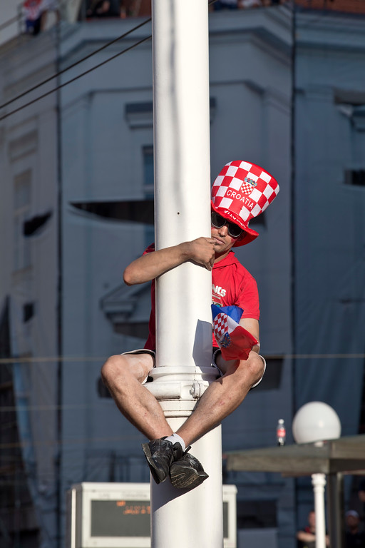. A supporter of the Croatian national soccer sits on a lampost in central Zagreb, Croatia, Sunday, July 15, 2018. Croatia\'s national soccer team lost to France in the World Cup final in Russia. (AP Photo/Marko Drobnjakovic)