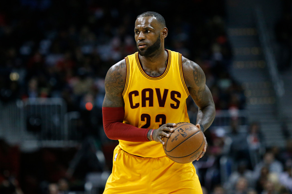 . Cleveland Cavaliers forward LeBron James (23) dribbles against the Atlanta Hawks in the second half of an NBA basketball game, Friday, March 3, 2017, in Atlanta. The Cavaliers won 135-130. (AP Photo/Brett Davis)