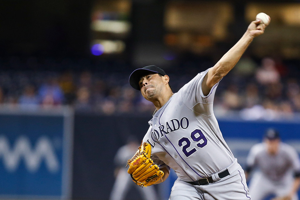 . Colorado Rockies starting pitcher Jorge De La Rosa works against the San Diego Padres in the first inning of a baseball game Tuesday, Sept. 23, 2014, in San Diego. (AP Photo/Lenny Ignelzi)