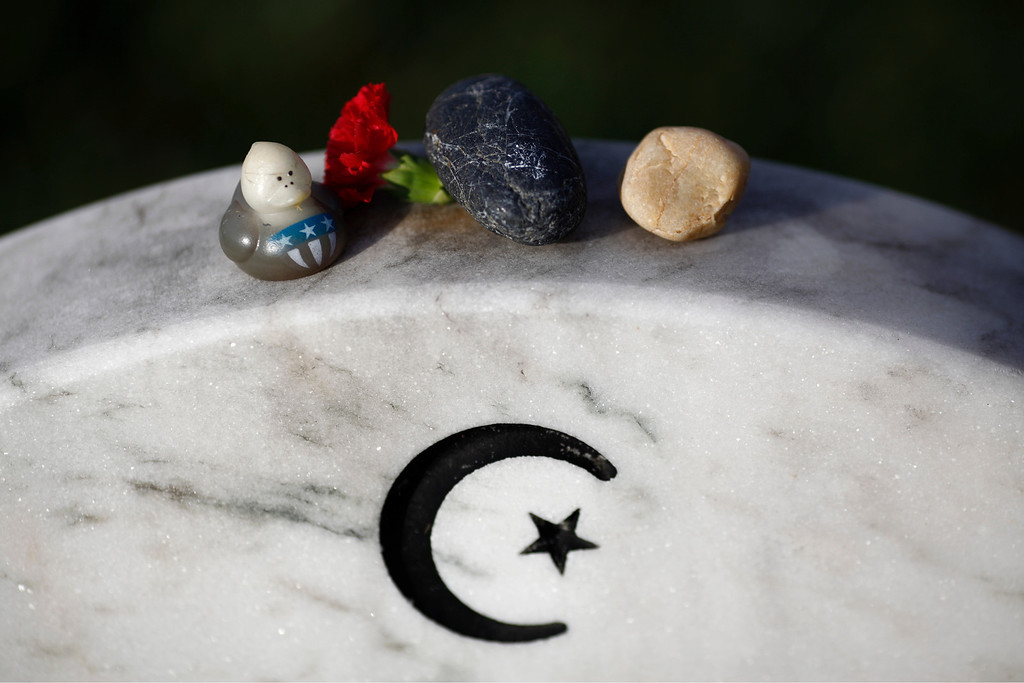 . The gravestone of Army Capt. Humayun Saqib Muazzam Khan, who died June 8, 2004, in Baquba, Iraq, in section 60 of Arlington National Cemetery on Memorial Day in Arlington, Va., May 28, 2012.  (Luke Sharrett/The New York Times)