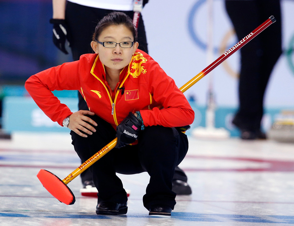 . China\'s skip Wang Bingyu watches her throw during women\'s curling competition against Switzerland at the 2014 Winter Olympics, Monday, Feb. 17, 2014, in Sochi, Russia. (AP Photo/Robert F. Bukaty)